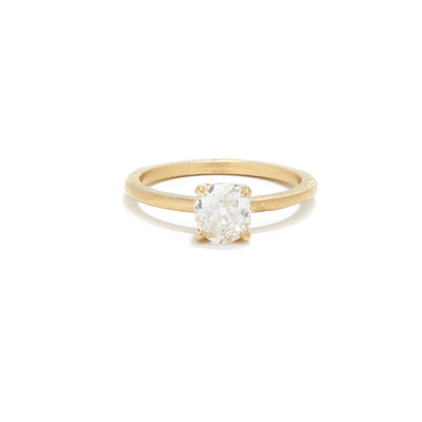 Custom engagement ring in 18kt gold with an old mine cut diamond and diamond gallery. Handmade in Brooklyn.