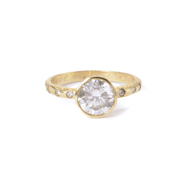Custom diamond engagement ring with side diamonds and texture. Handmade in 18kt gold in Brooklyn.