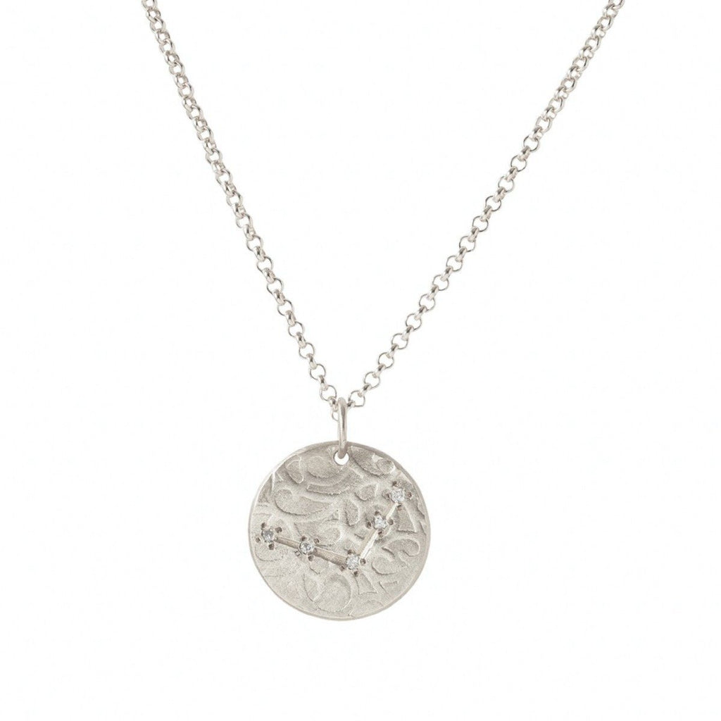 Handmade Libra zodiac constellation charm pendant in sterling silver with diamonds