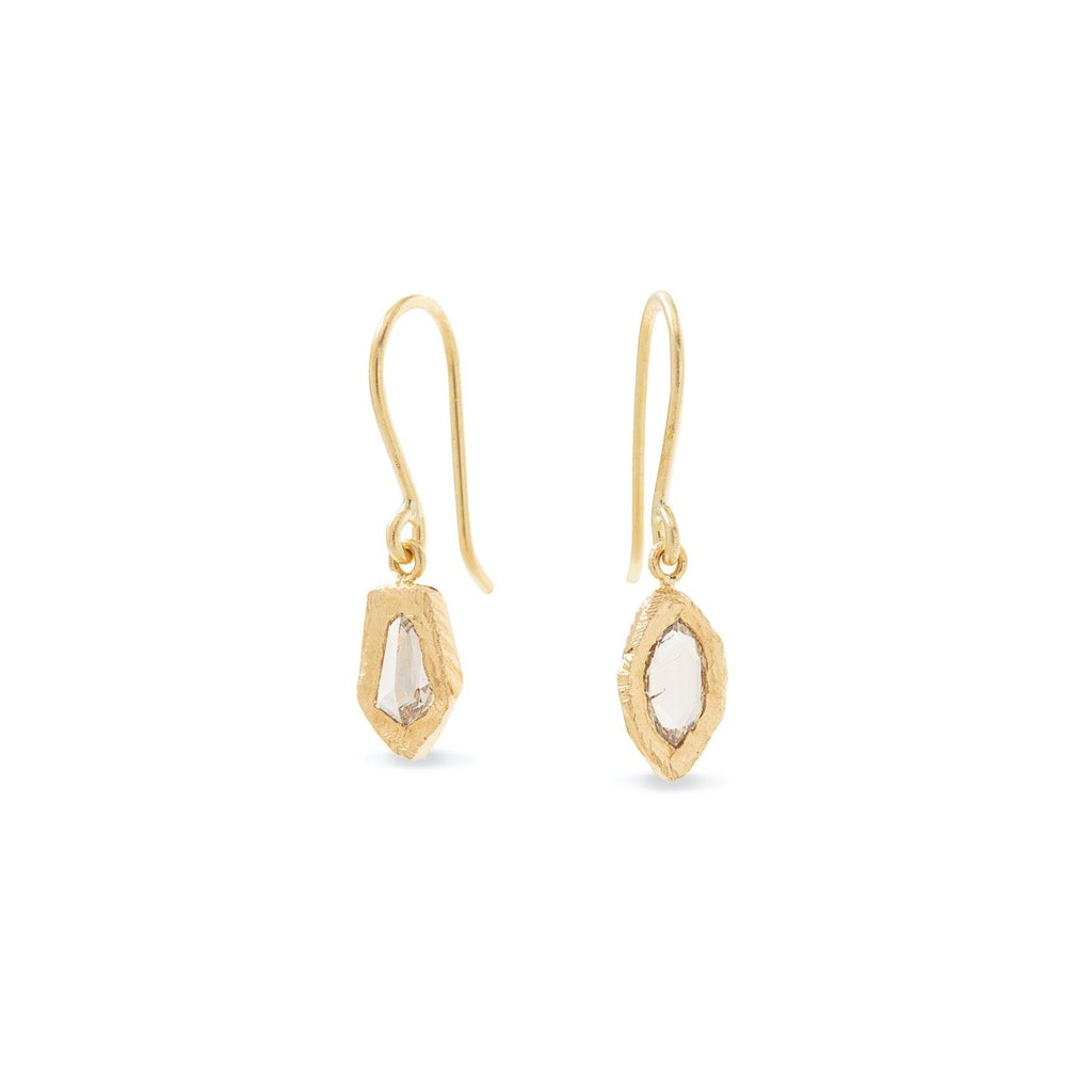 Handmade earrings in 18kt gold with asymmetrical rose cut diamonds.