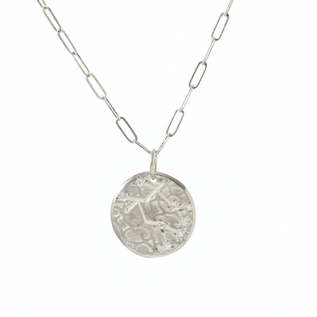 Handmade Gemini zodiac constellation charm pendant in sterling silver with diamonds