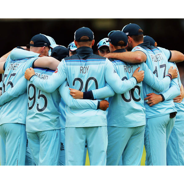 England huddle before they go out to field