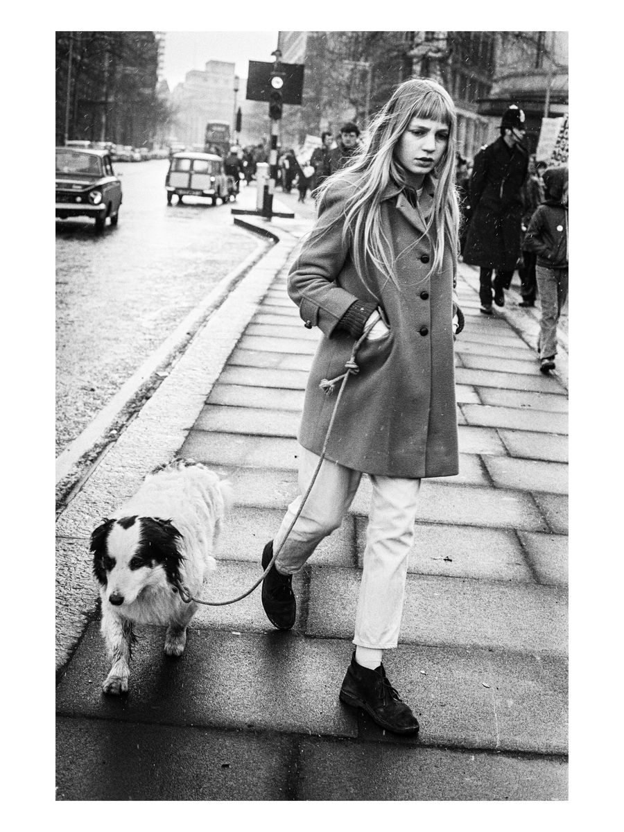 A young woman and her dog on the march, 1971