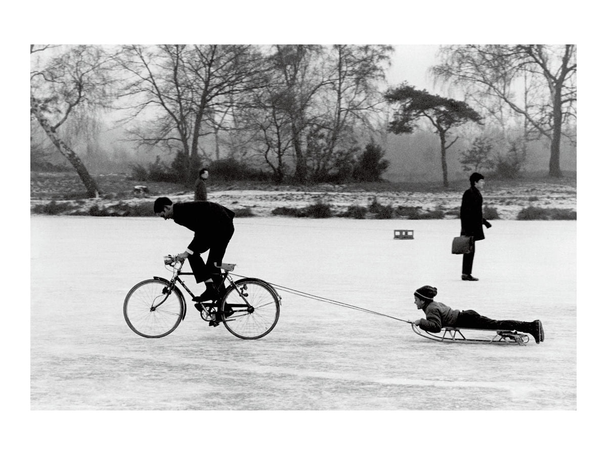Playing on a frozen pond, Wimbledon Common, 1970