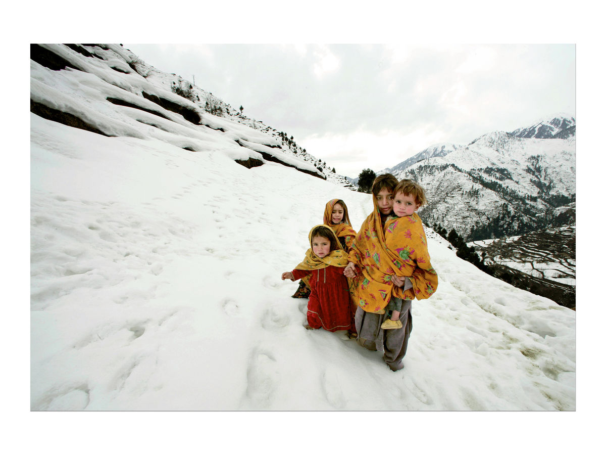 Young girls walk in the snow, Pakistan, 2006