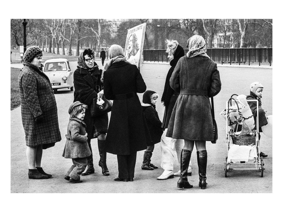 A demonstrator engages with passers-by, 1971