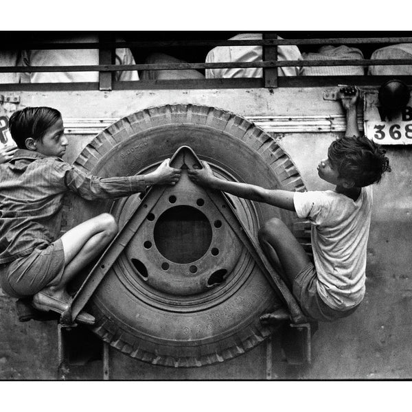 Boys clinging on to the back of a bus in Kolkatta, known at the time as Calcutta, India, 1977