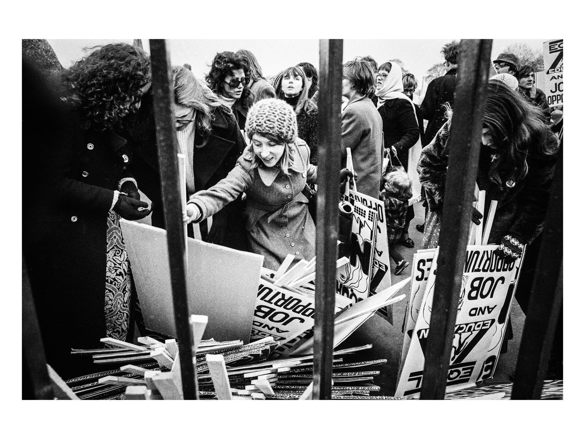 Placards are collected before the start of the march, 1971