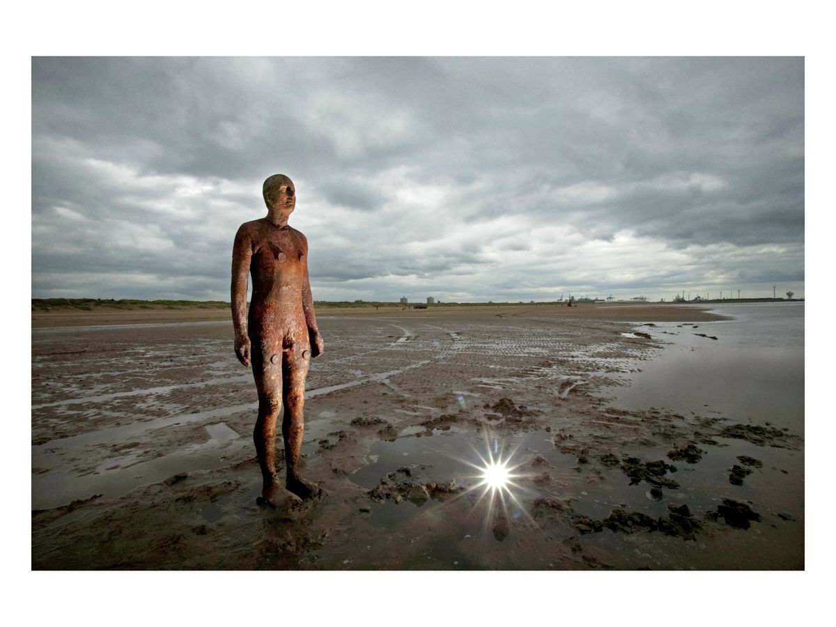 Antony Gormley statue at Crosby