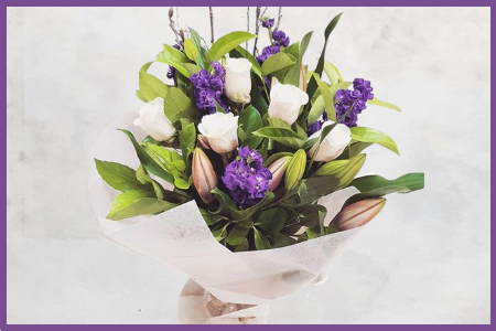 Gentle Calm bouquet of purple and white flowers available at The Flower Scene