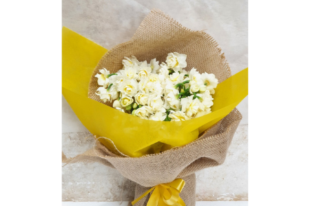 Flowers on the week double bunch of jonquils wrapped in hessian and yellow paper with a yellow ribbon mobile image