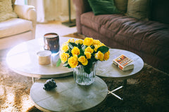 Yellow flowers on a lounge room table – Photo by Maria Orlova from Pexels