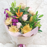 Bouquet of roses, lilies, stock, chrysanthemums and greenery