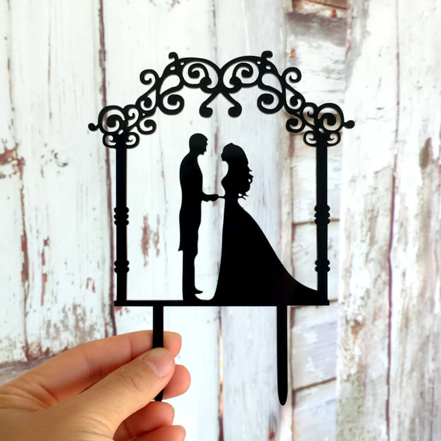 Silhouette Bride and Groom Under Floral Arch Wedding Cake Topper