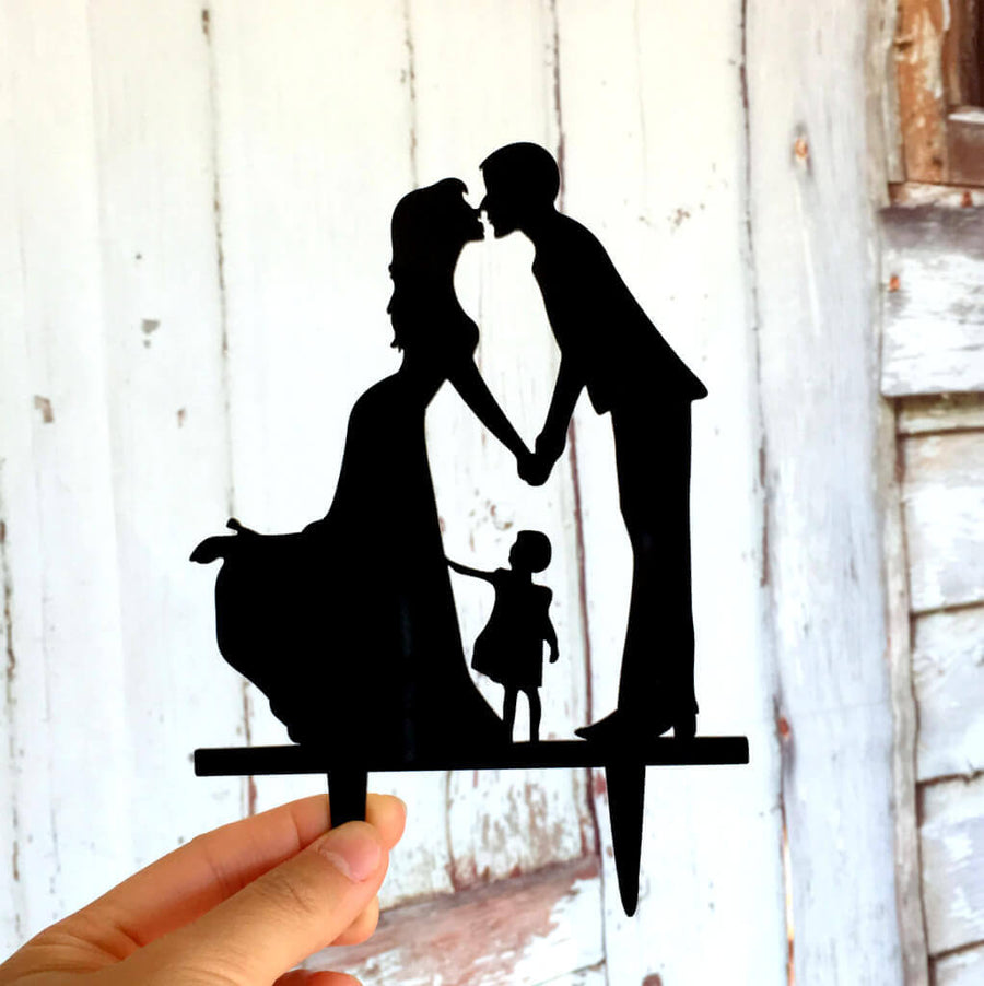 Silhouette Kissing Bride and Groom with a Girl Wedding Family Cake Topper