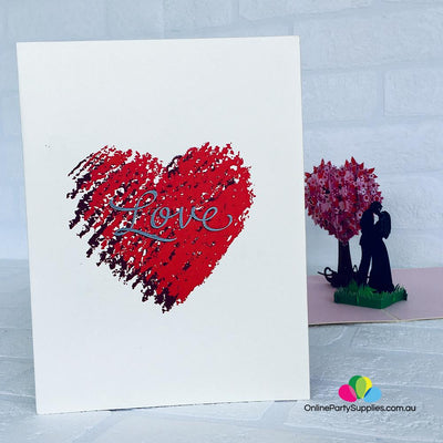 Handmade Silhouette Couple Kissing Near Pink Heart Tree 3D Pop Up Card - Online Party Supplies