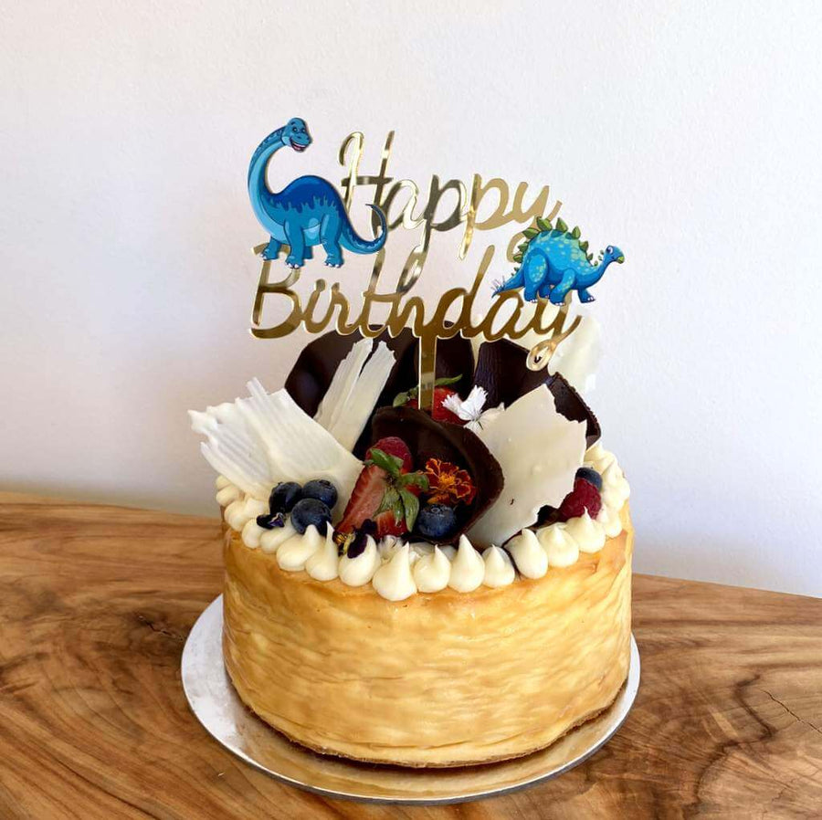 Laser Cut Gold Mirror Acrylic Happy Birthday Script with Blue Dinosaur Cake Topper