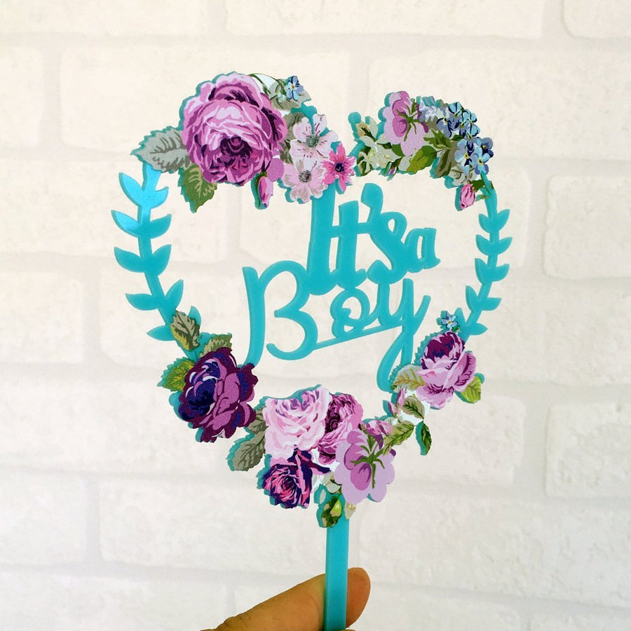 Matte Blue Acrylic 'It's a Boy' Floral Heart Shaped Wreath Cake Topper - Online Party Supplies