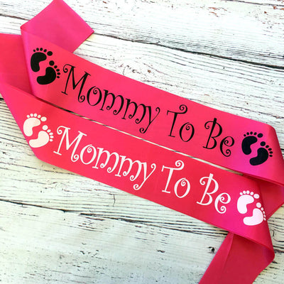 One Size Fits All Pink Online Party Supplies Mommy To Be with Black and White Footprints Baby Shower Satin Sash