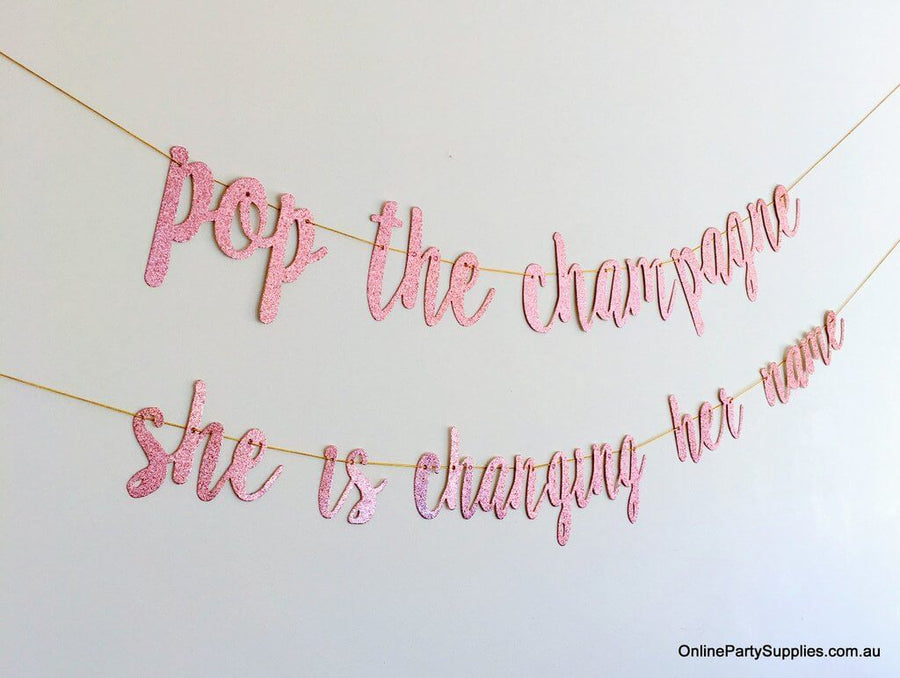Online Party Supplies Australia Rose Gold Glitter 'Pop The Champagne She Is Changing Her Name' Bridal shower hen party Banner