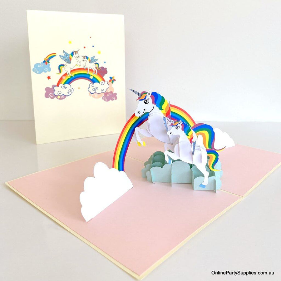 White Unicorn Mum and Baby Jumping Under Rainbow Card