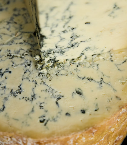 Stack of Colston Bassett Stilton blue cheeses