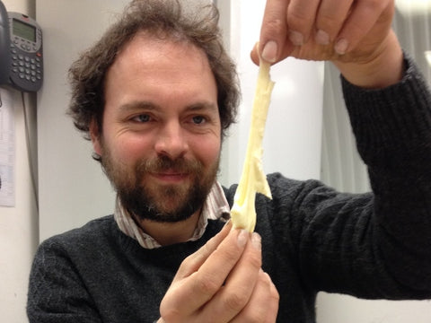 Johnny Crickmore with an experimental Baron Bigod cheese, this example is very stretchy.