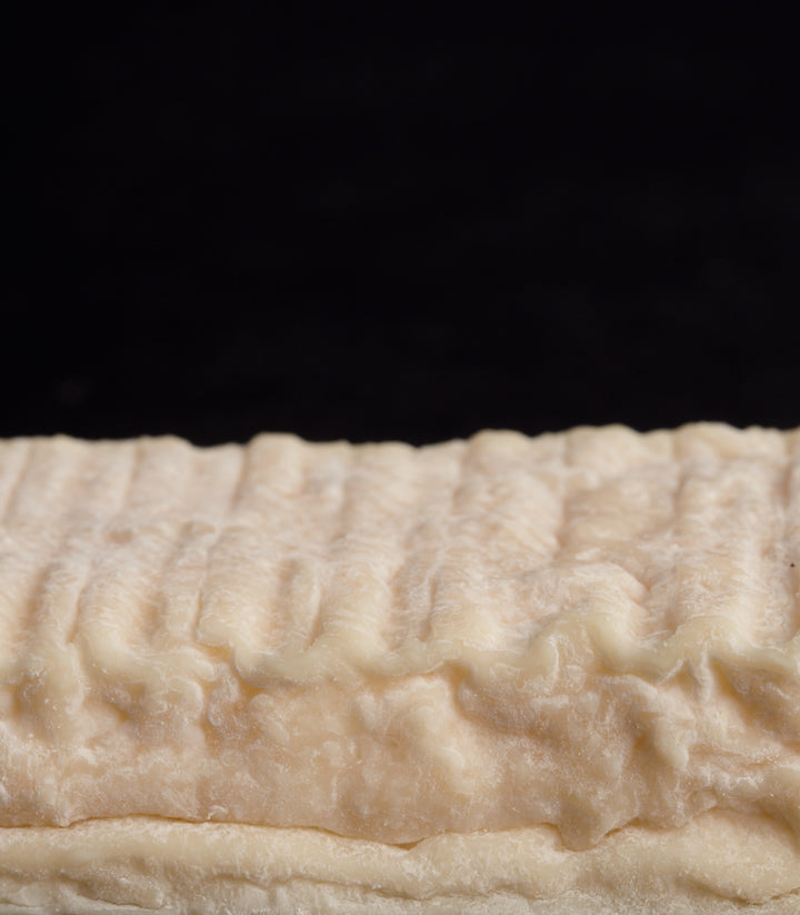 Close up of the delicate pinky-coloured, wrinkly rind of the Innes Brick goat's cheese