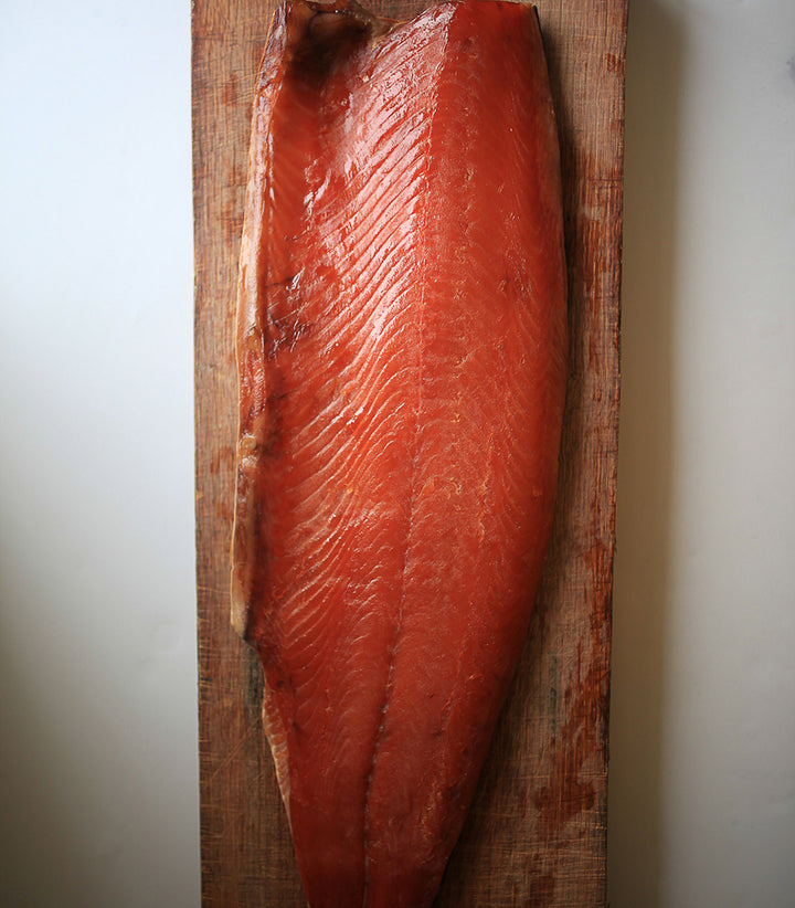 A deep reddish-pink side of wild, traditionally-smoked salmon from Ireland