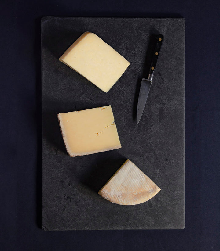 Selection of three cheeses for a weekend treat, Kirkham's Lancashire, Lincolnshire Poacher, Durrus