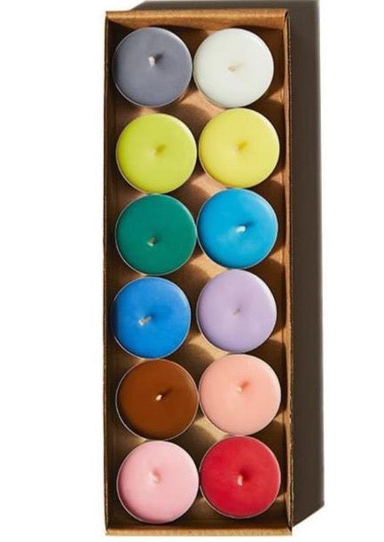 Rainbow colored tea lights in a brown paper package
