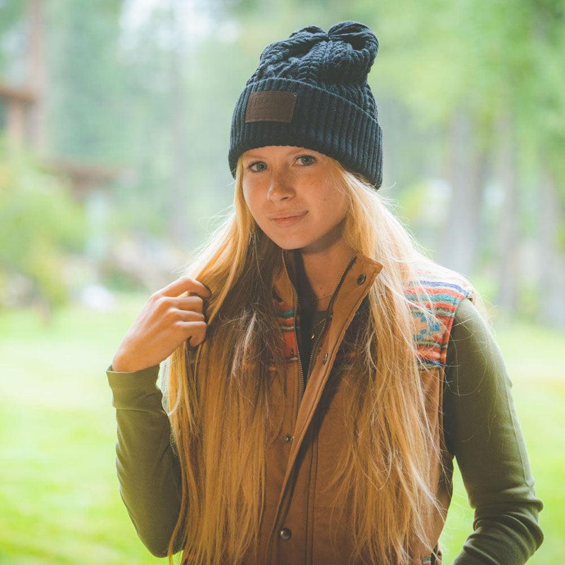 female model wearing black hooey beanie with leather patch on front
