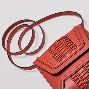 YLIANA YEPEZ mini giovanna braided burnt orange clutch
