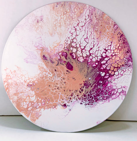 "Upcycled abstract acrylic fluid or pour painting on a 12-inch vinyl record.  One-of-a-kind item handcrafted in California.  Magenta and salmon on a white background, created using the ""Dutch pour"" technique."
