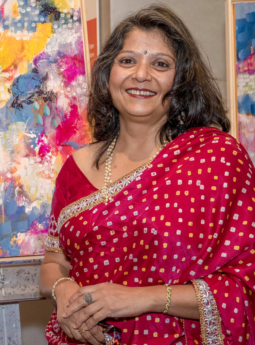 Picture of Artist Rina Patel in a traditional pink saree