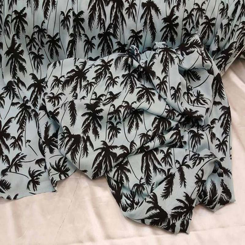 100% Rayon challis black Palm tree on baby blue background - IceFabrics