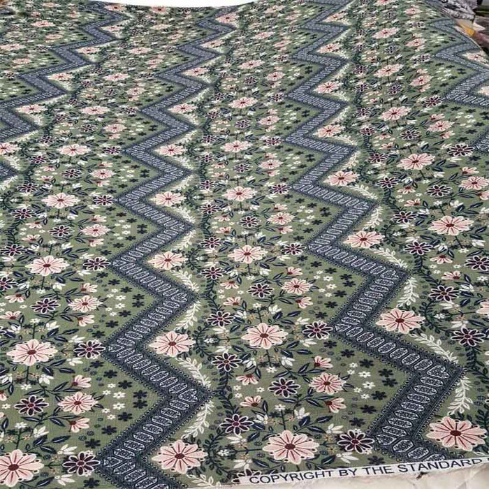 100% Rayon. Corrugated rayon full of pink flowers on a light olive green background Fabric by the yard soft organic kids dress draping soft - IceFabrics
