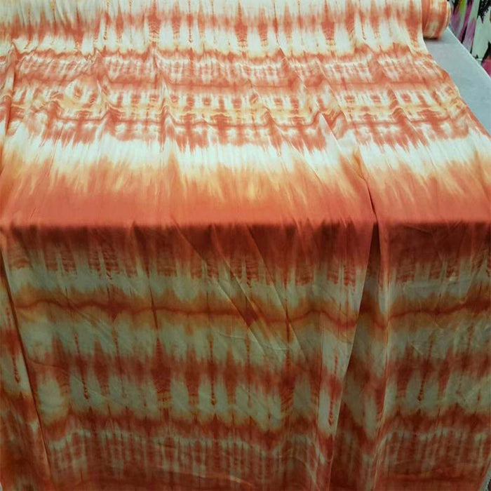 100% Rayon challis Tie dye orange hues Off white background fabric sold by the yard clothing dress soft flowy organic kids dress draping - IceFabrics