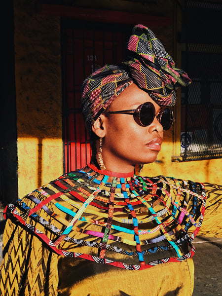 woman wearing Zuberi bone and brass maasai earrings | 2 Sydney Stylists Loves