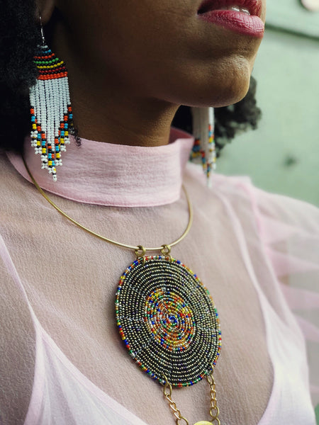 woman wearing Subira beaded fringe Maasai earrings | 2 Sydney Stylists Loves