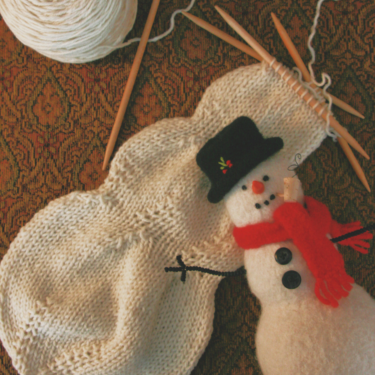 knitted woolly snowman