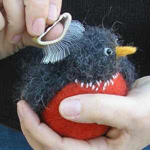 woolly bird being brushed with a nap riser
