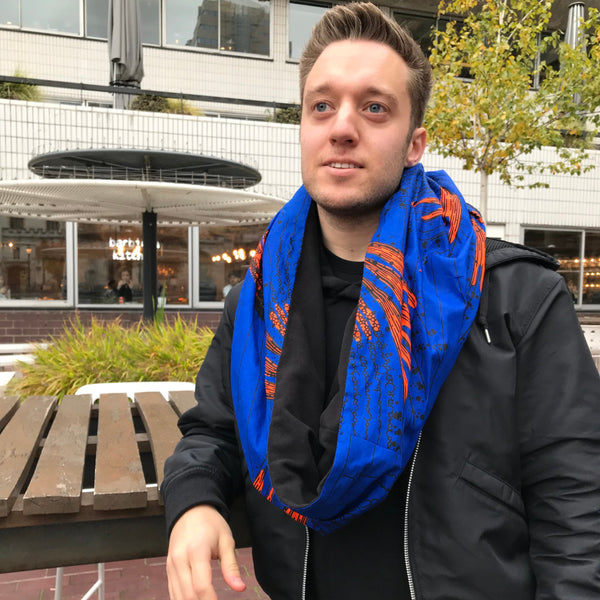 white man wearing African print scarf