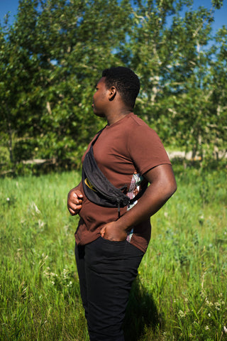 African print t-shirt with black jeans and nike fanny pack