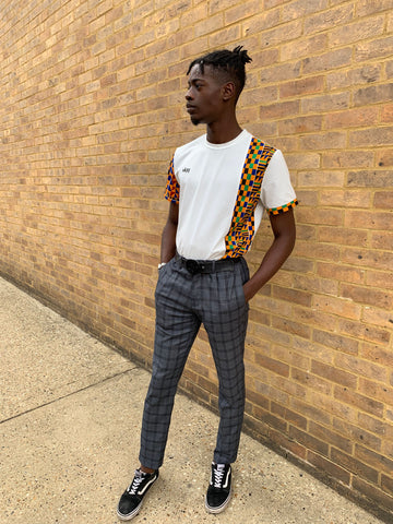 Kente african print t-shirt with grey checkered trousers and vans