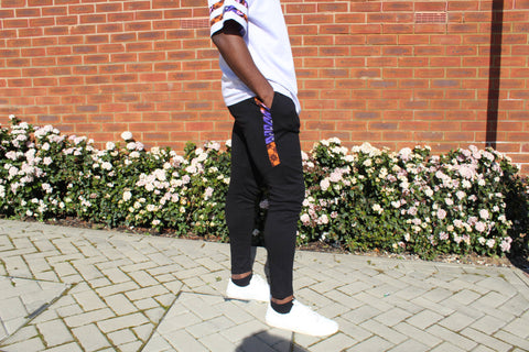 African print oversized t-shirt and joggers with white trainers