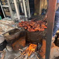 Beef and chicken suya on charcoal grill