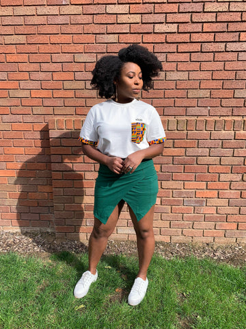 Kente African Print T-shirt with green skirt and white sneakers
