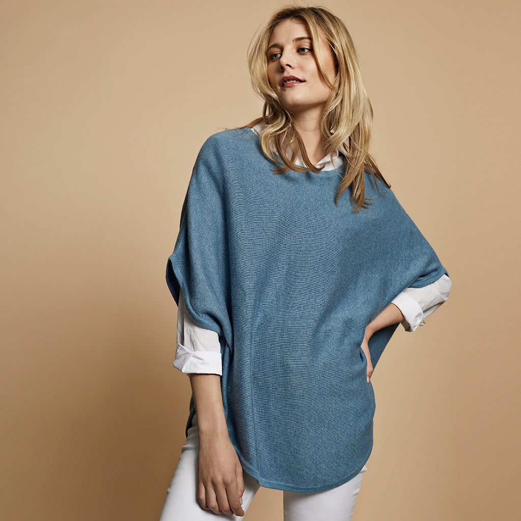 flora reversible poncho sky blue and clean denim