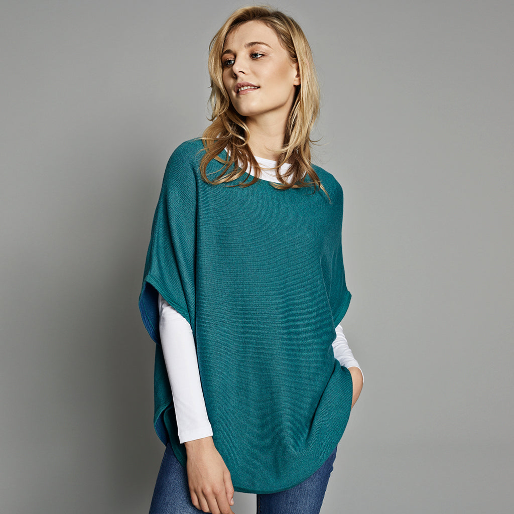 flora reversible poncho teal and hoxton blue
